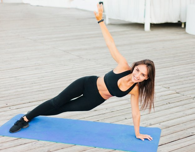 young fit woman doing side plank mat 175682 6382